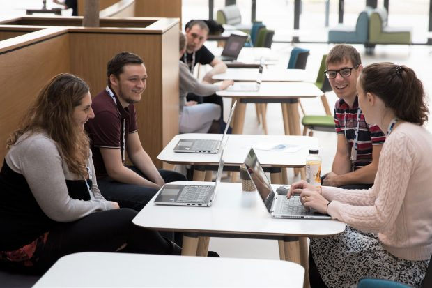 UKHO employees with their laptops in an informal 'coffee and code' meeting