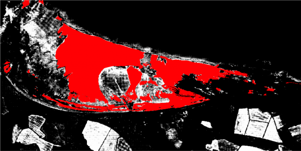 The same black and white aerial image of blue anchor, with a section of the white area (that indicates sand) now shaded in red.