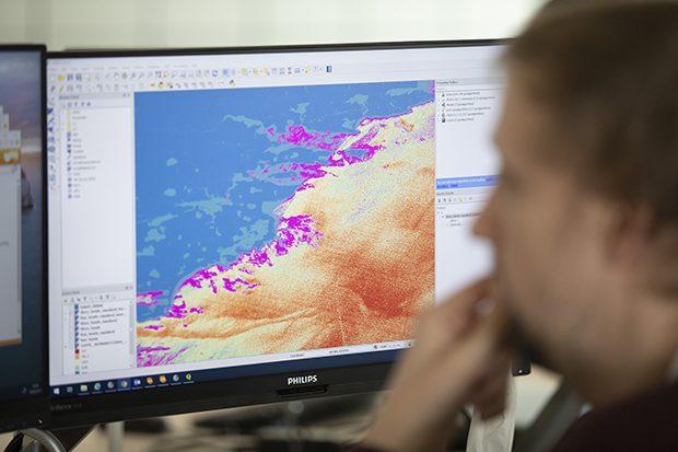 UKHO staff analysing coastal data sets