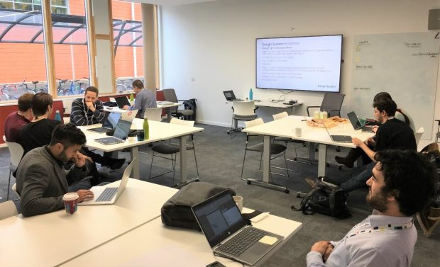 Staff on laptops during a hackathon