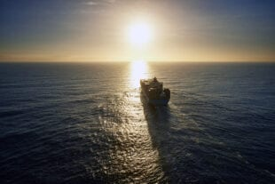 Sunset view of a large vessel in open water